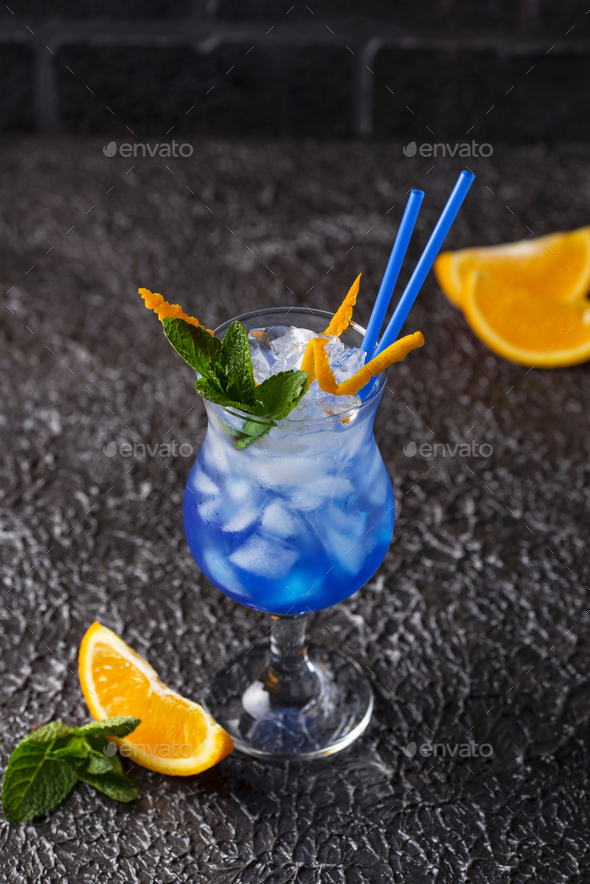Blue cocktail drink with ice and orange - Stock Photo - Images