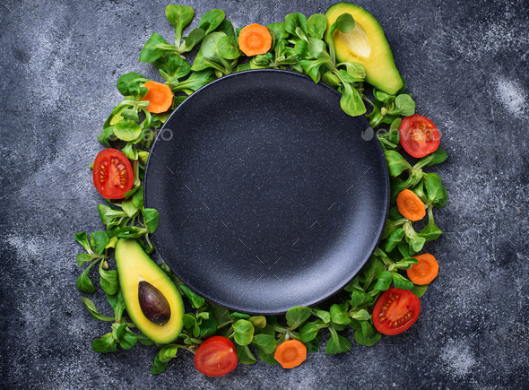 A frame of vegetable around the plate. - Stock Photo - Images