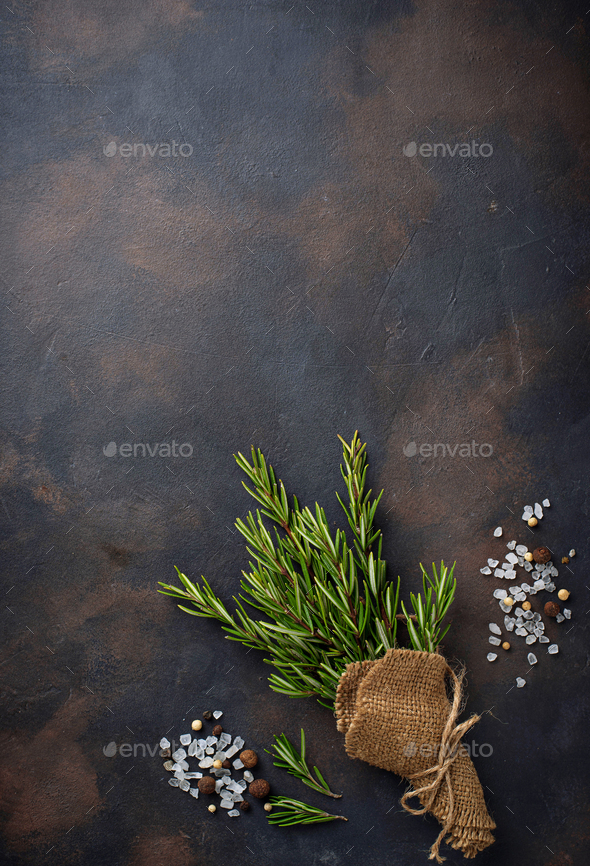 Bunch of fresh rosemary on dark background - Stock Photo - Images
