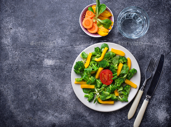 Healthy vegetable salad and glass of water - Stock Photo - Images