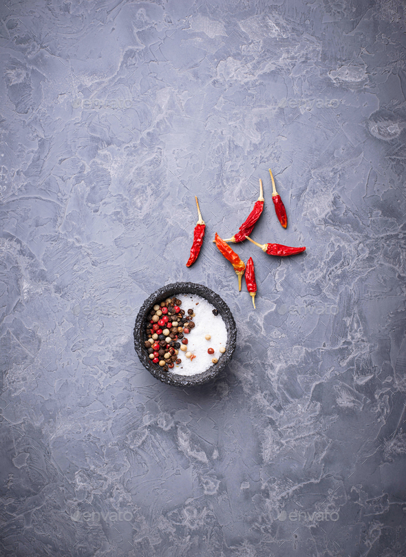 Mix of peppers and salt on gray background - Stock Photo - Images