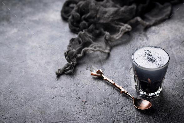 Black charcoal latte.  Detox drink. - Stock Photo - Images
