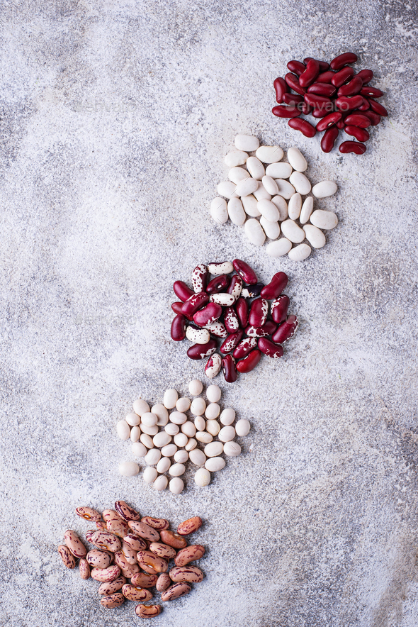 Assortment of various beans on light  background - Stock Photo - Images