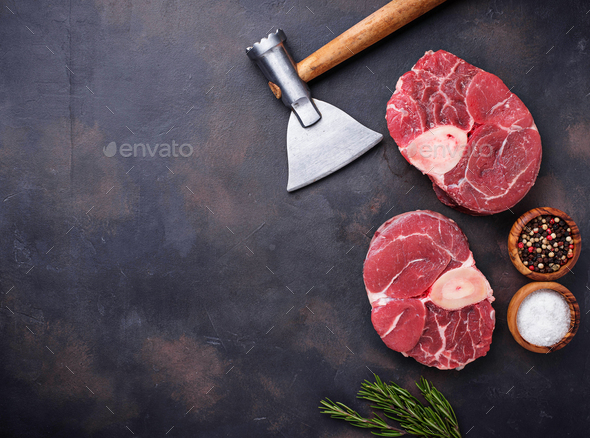 Raw meat osso buco and butchers axe - Stock Photo - Images