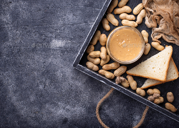 Homemade peanut butter and nuts - Stock Photo - Images