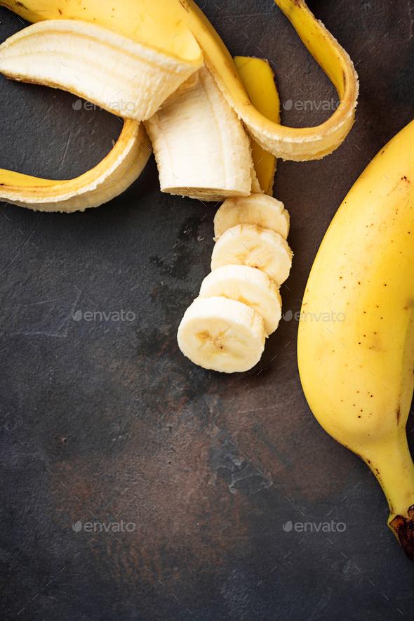 Fresh sliced banana on dark background - Stock Photo - Images