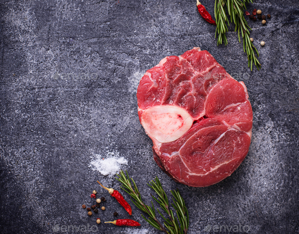 Raw meat osso buco with spices - Stock Photo - Images