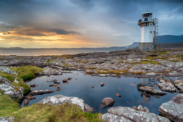 Stormy sunset at Rhe lighthouse near Ullapool - Stock Photo - Images