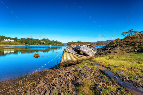 An old fishing boat on the shore of Gair Loch at Badachro - Stock Photo - Images