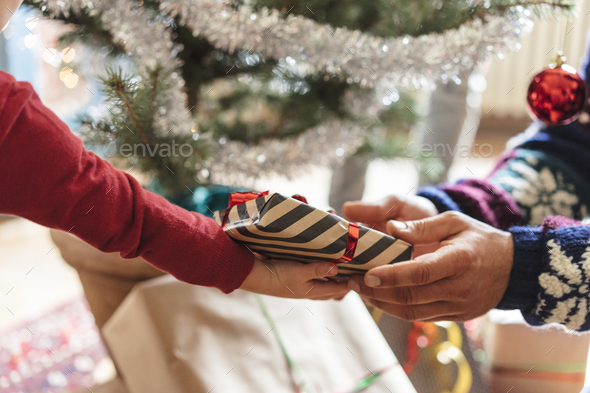 family at home sharing presents for christmas - Stock Photo - Images