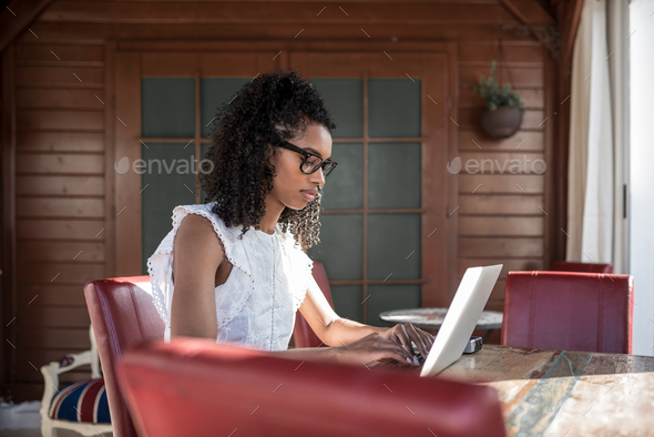 Businesswoman working from home on his computer - Stock Photo - Images