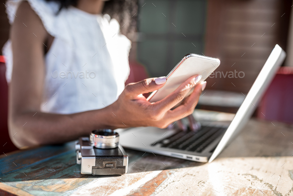 Businesswoman working from home on the mobile phone - Stock Photo - Images