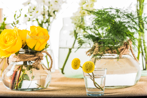 Bunch of flowers bouquets in vases - Stock Photo - Images