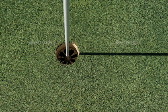 Golf field with empty hole - Stock Photo - Images