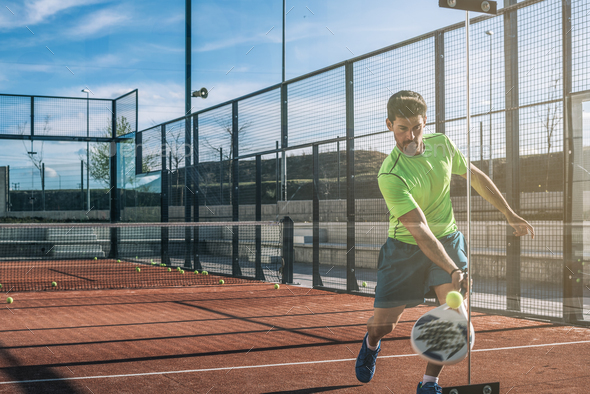 Man playing padel - Stock Photo - Images