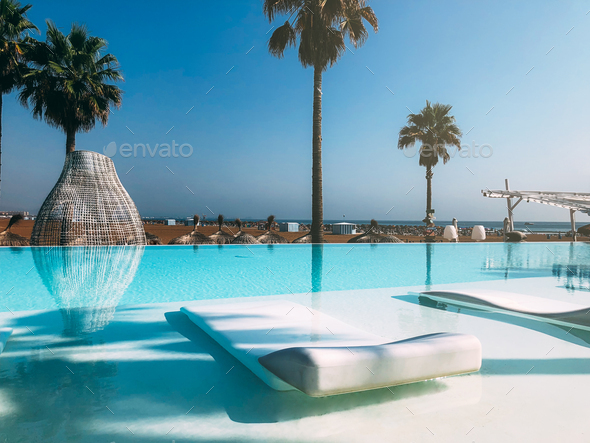 Luxury swimming pool on the beach - Stock Photo - Images