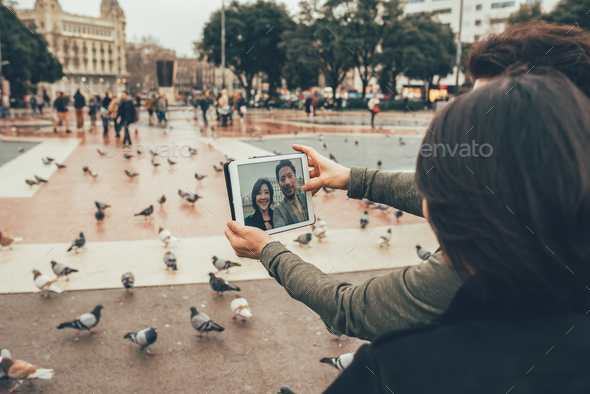Asian tourist couple taking a selfie on the tablet - Stock Photo - Images