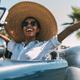 Black woman driving a vintage convertible car - PhotoDune Item for Sale