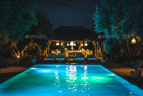 Swimming pool by night - Stock Photo - Images