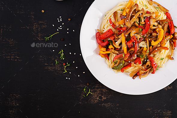 Noodles with shimeji mushrooms and paprika. Oriental meal. Japanese Shimeji mushroom stir fry. - Stock Photo - Images