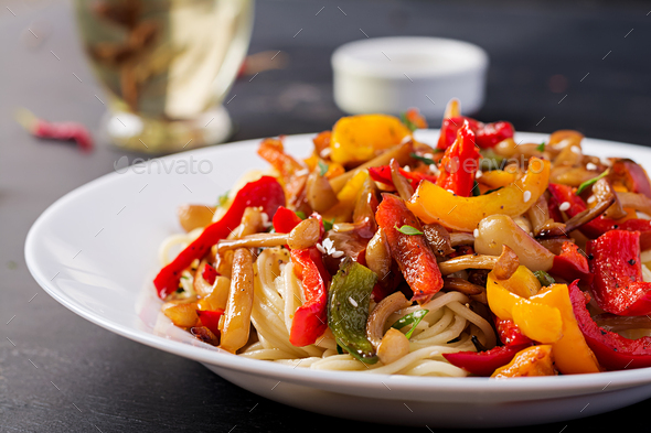 Noodles with shimeji mushrooms and paprika. Oriental meal. Japanese Shimeji mushroom stir fry. - Stock Photo - Images