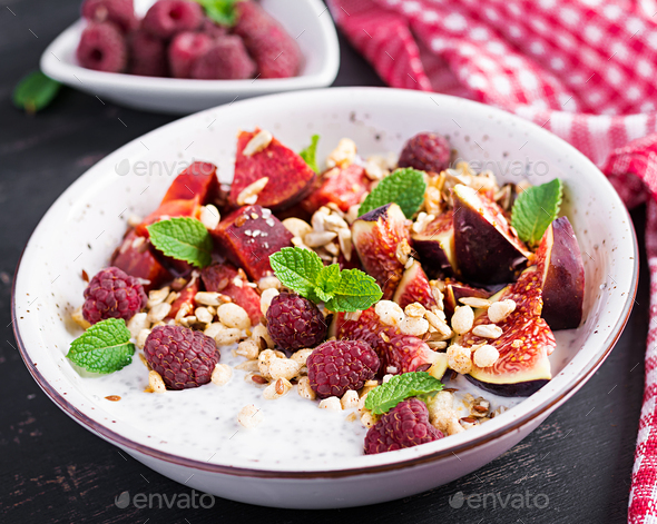 Chia seed pudding made with raspberries,  figs and mint on dark - Stock Photo - Images