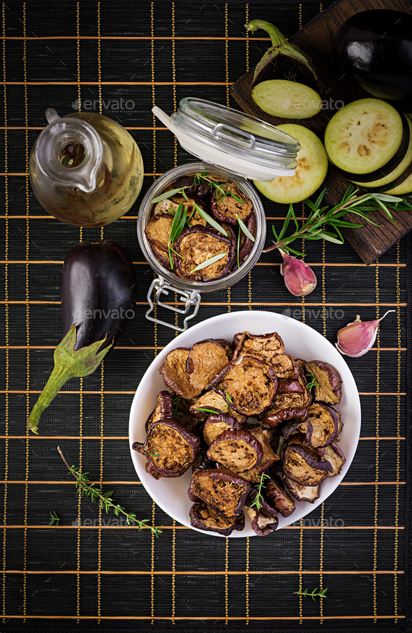 Italian sun-dried eggplant on a dark table. Preserved food. Italian appetizer. Top view - Stock Photo - Images
