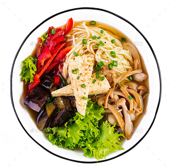 Asian vegan noodles soup with tofu cheese, shimeji mushrooms and fried eggplant - Stock Photo - Images