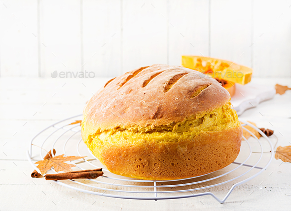 Fresh homemade pumpkin bread and pumpkin slices. - Stock Photo - Images