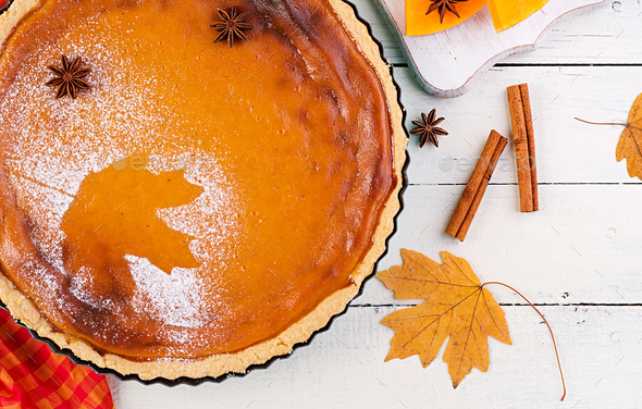 American homemade pumpkin pie with cinnamon and nutmeg, pumpkin - Stock Photo - Images