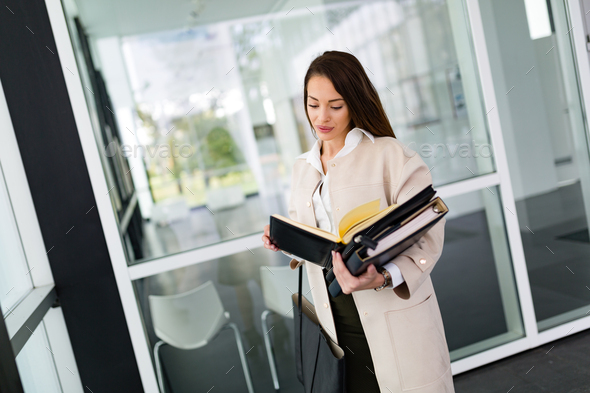 Portrait of young businesswoman going to office - Stock Photo - Images