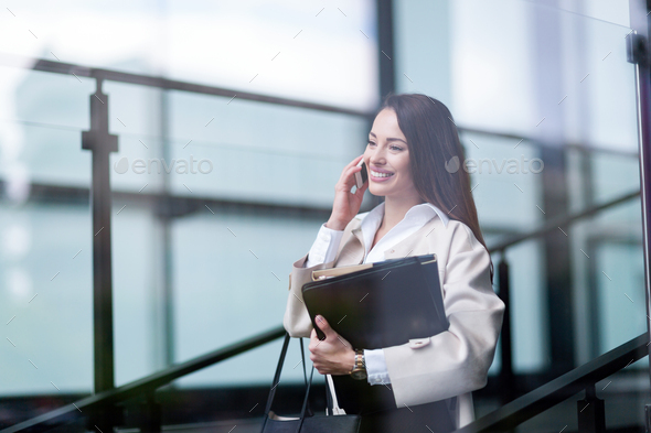 Portrait of young beautiful businesswoman going to office - Stock Photo - Images
