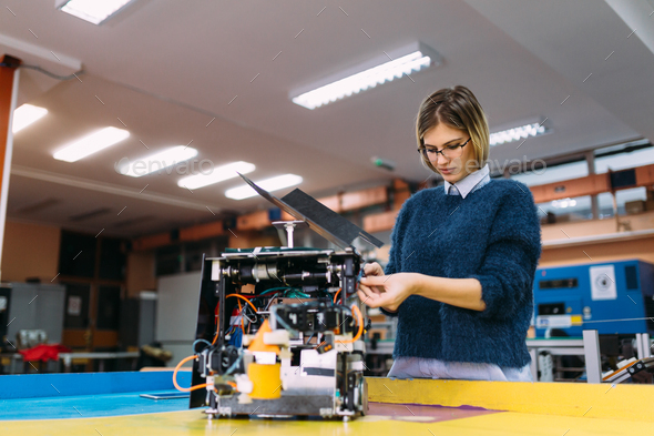 Young student of robotics working on project - Stock Photo - Images