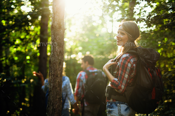 Group of backpacking hikers going for forest trekking - Stock Photo - Images