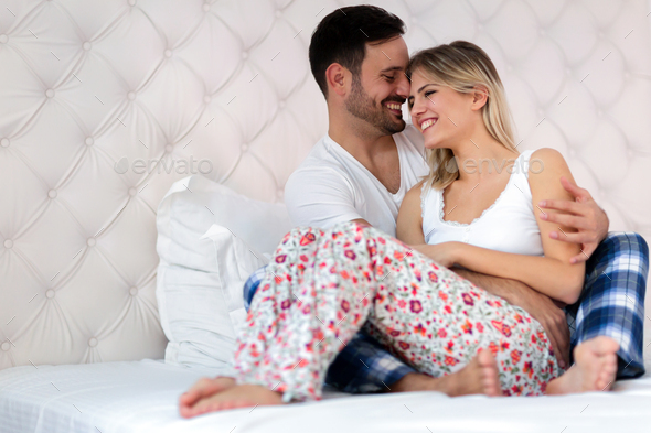 Happy couple having romantic times in bedroom - Stock Photo - Images