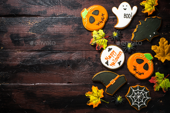 Halloween Gingerbread Cookies - pumpkin, ghosts, bat, on woden table - Stock Photo - Images