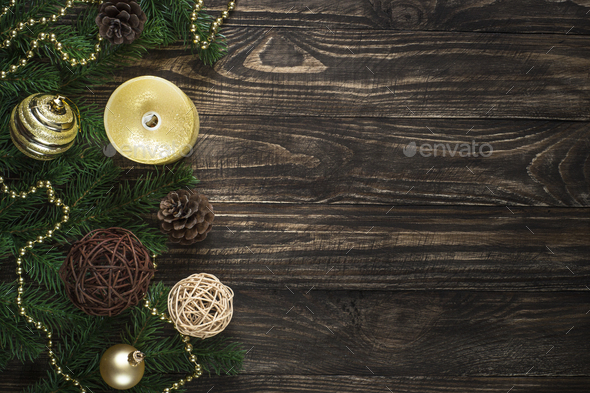 Christmas background with candle and decorations on dark wooden - Stock Photo - Images