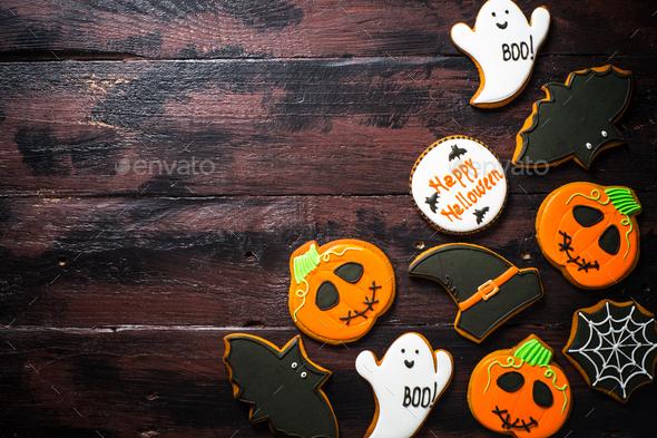 Halloween Gingerbread Cookies - pumpkin, ghosts, bat, on woden table - Stock Photo - Images