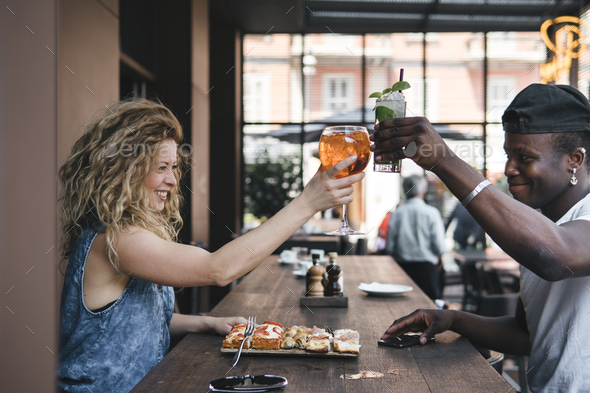 mixed race couple together in a restaurant - Stock Photo - Images