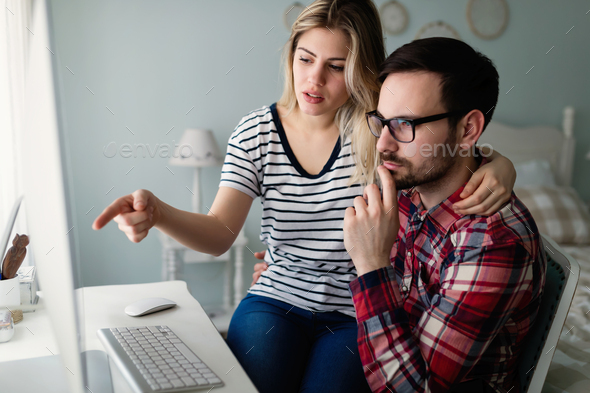 Young attractive designers working together from home - Stock Photo - Images