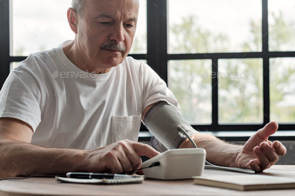 Man checking a blood pressure in the morning - Stock Photo - Images