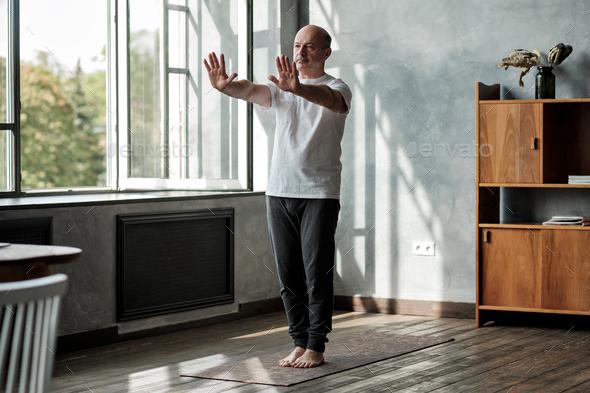 Hispanic man working out, yoga in basic standing asana tadasana - Stock Photo - Images