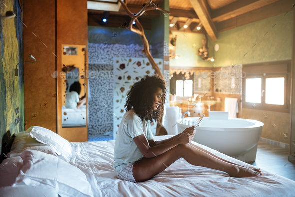 Woman on the bed with tablet - Stock Photo - Images