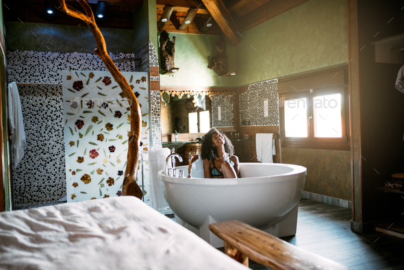 Young woman relaxing in the hydro massage bath - Stock Photo - Images