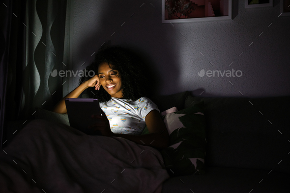 Woman in pajamas with a tablet - Stock Photo - Images