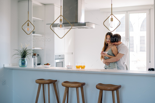 Couple having breakfast at home - Stock Photo - Images
