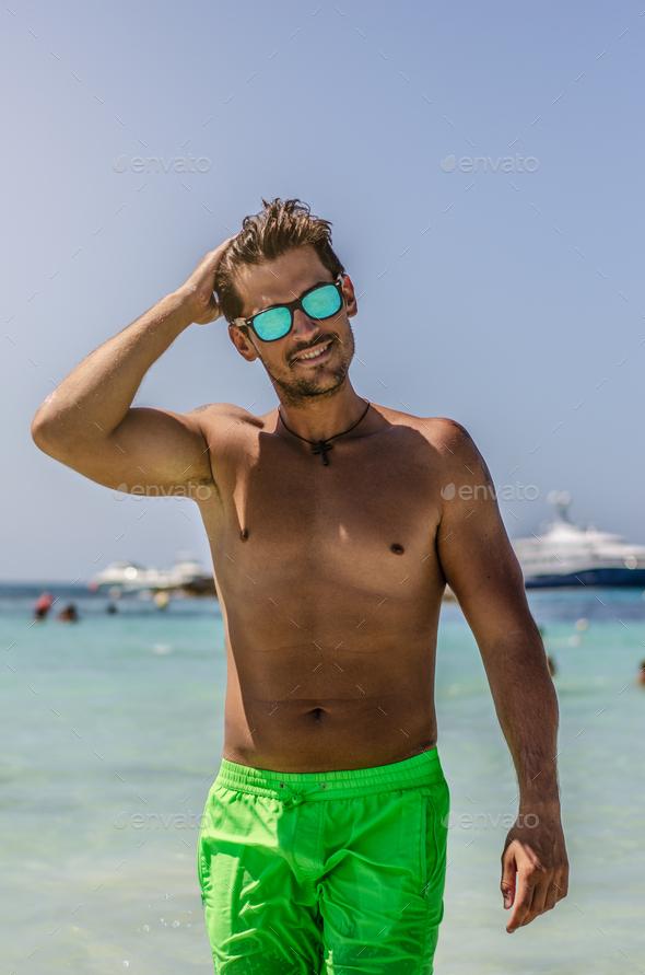 Shirtless man enjoying the beach - Stock Photo - Images