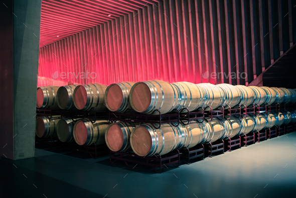 Wine barrels stored in a winery on the fermentation process - Stock Photo - Images