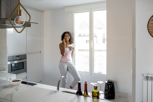 Woman drinking coffee with mobile phone - Stock Photo - Images