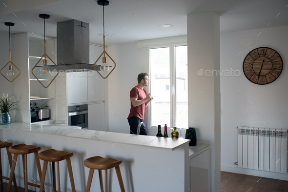 Man having breakfast by the windows - Stock Photo - Images